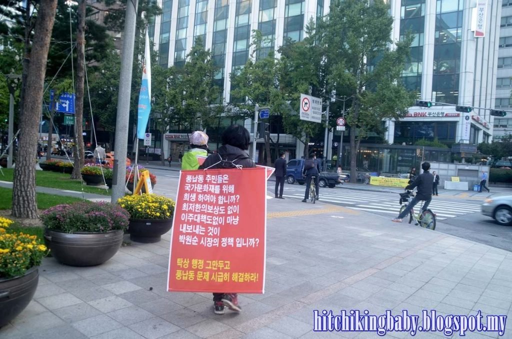 woman-with-banner-at-seoul-city-hall